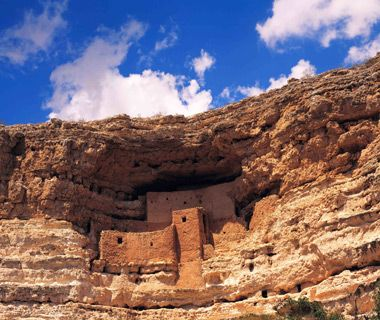 Montezuma Castle, National Monument, Arizona-Don't be misled by the name: neither castle nor anything else having to do with the Aztec ruler from central Mexico, this five-story, 20-room structure was built into a cave 70 feet up the cliff-face by the Ancestral Puebloan people (sometimes called the Anasazi). Short T-shaped doorways—which kept heat in and drafts out—were put into what is one of America's best-preserved cliff dwellings, constructed 800 years ago.