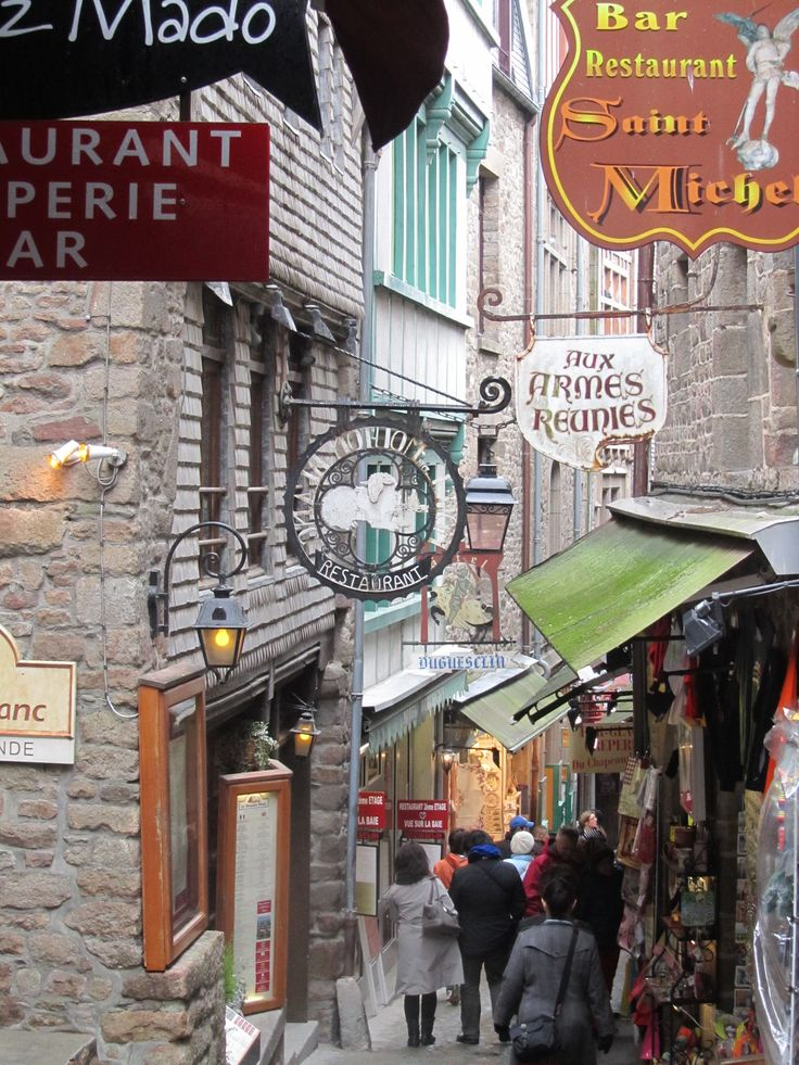 Normandy, France – Mont Saint-Michel, built before the year one thousand on a rock in a bay off the Atlantic ocean , a pre-Romanesque monastery - city street