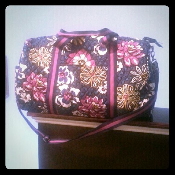 Vera Bradley travel bag Large, purple multi-colored , adjustable shoulder strap, several compartments within bag, used once, excellent condition. Vera Bradley Bags Travel Bags