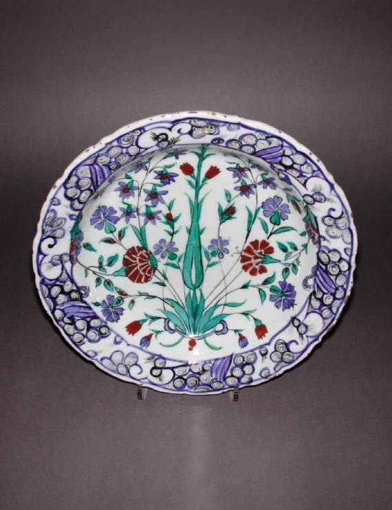 Maker: Unknown; potter Category: fritware (stonepaste) Name(s): dish Islamic pottery; category Iznik; category Date: circa 1565 — circa 1575 School/Style: Ottoman Period: 3rd quarter of 16th century