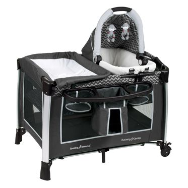 Baby Trend grey chevron and pack n play. Removable bassinet. Flip up changing table. Full size sleeper at 2 heights. Diaper and accessory organizer. Nightlight, sound and vibrations.