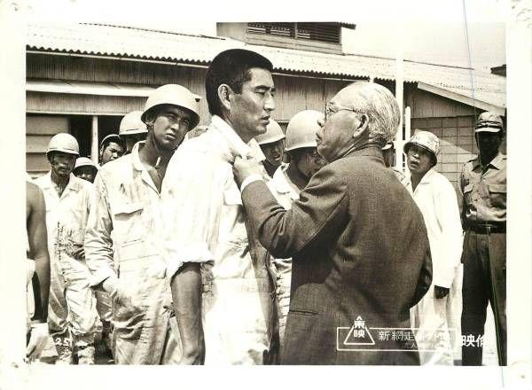 Lobby card for New Abashiri Prison: Duel at Runin Key (新網走番外地 流人岬の血斗), 1969, directed by Yasuo Furuhata (降旗康男) and starring Ken Takakura (高倉健) and Takashi Shimura (志村喬).