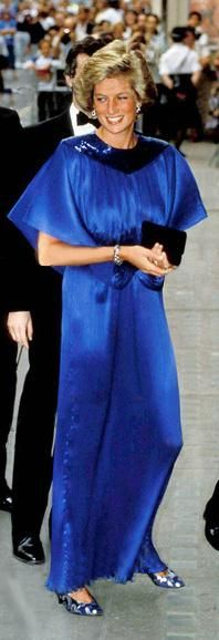 Royal blue Fortuny-style dress decorated with blue bugle beads at the neckline and waist. Designer: Yuki