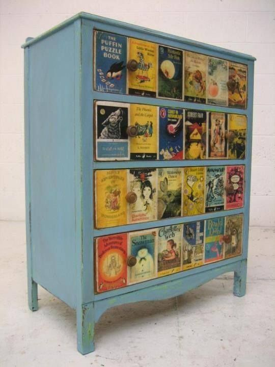 Dresser decoupaged with copies of Children's book covers. Would be pretty cool for a nursery. Perhaps a Dr. Seuss theme?