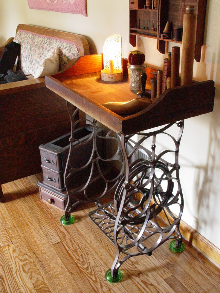My husband made this from an old dry sink top and a rusted old sewing machine stand. He is awesome!