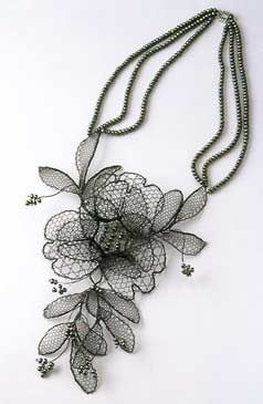 """""""Chantilly Necklace."""" Chantilly Necklace Lenka Suchanek Dimensions 250 x 480 x 30 mm Materials Neckpiece: bobbin lace using black enamelled copper wire with Swarowski crystals; centrepiece made in gold-plated wire"""