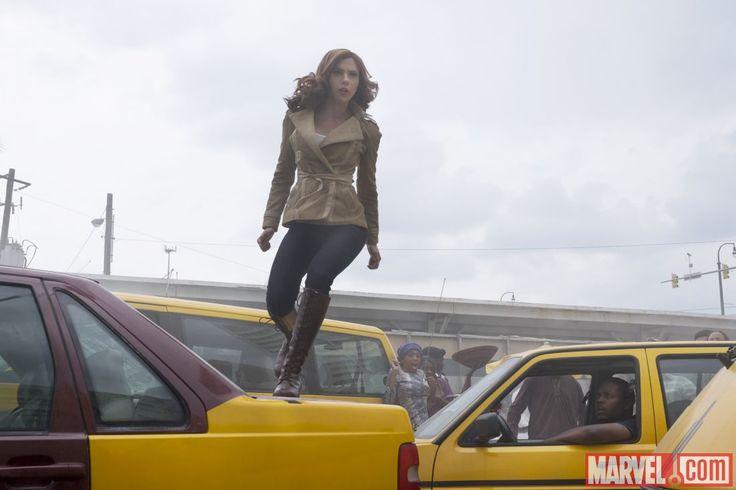 Black Widow (Scarlett Johansson) bounds across cars in Marvel's 'Captain America: Civil War.'