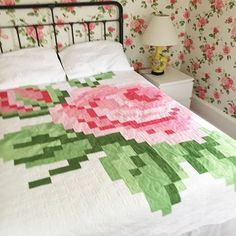 Too many roses? No such thing! Thanks to my mom, who made me this pixelated rose quilt (a free pattern from @rileyblakedesigns). I think we can all agree that cutting and piecing allllll those little squares was totally worth it. (Right, Mom?!) Now my man repeller bedroom is complete! #chezgertie #roses #alltheroses #rileyblakedesigns #quilting #thanksmom