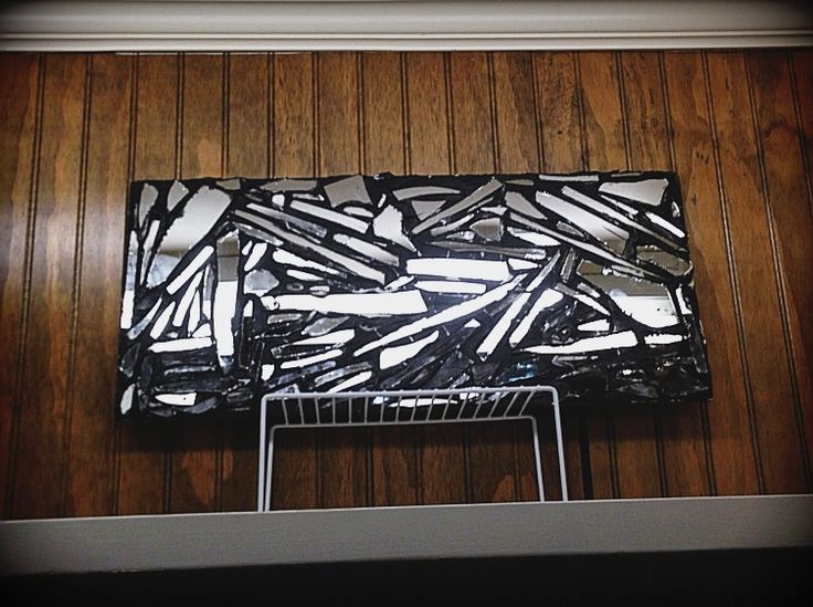 Broken mirror mosaic on wood art by Tara Merryman