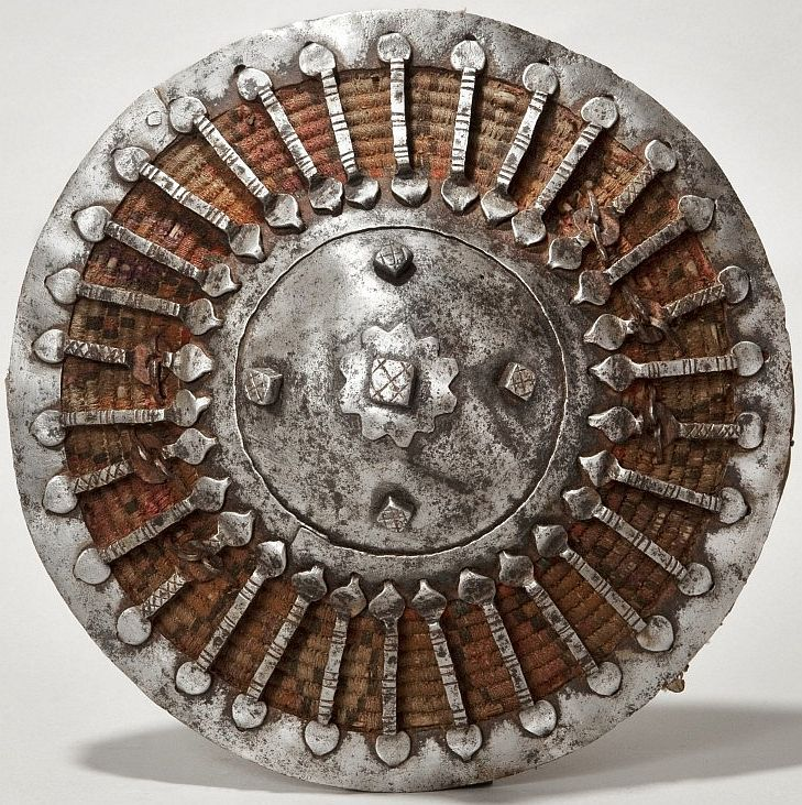 Ottoman kalkan (shield), 16th-17th century. Wicker, textile, steel, leather Diam. 26 cm.