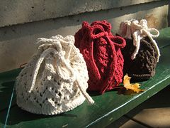 This holiday gift bag is a quick knit that will dress up even the simplest of gifts. The bag requires only one 2.5 ounce skein of cotton. You can even do a combination of colors to use up scrap yarn. Or, use more yarn and make the bag taller by adding more repeats of the lace.