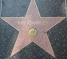 "Rolling Stone ranked Charles number ten on their list of ""100 Greatest Artists of All Time"" in 2004,[7] and number two on their November 2008 list of ""100 Greatest Singers of All Time"".[8] In honoring Charles, Billy Joel noted: ""This may sound like sacrilege, but I think Ray Charles was more important than Elvis Presley. I don't know if Ray was the architect of rock & roll, but he was certainly the first guy to do a lot of things . . . Who the hell ever put so many styles together."