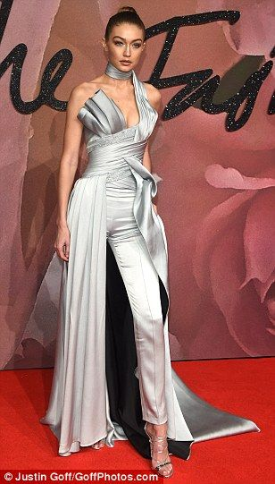 Leading the way: Gigi Hadid was hard to miss in a daring silver jumpsuit with a sophisticated off the shoulder detail as she made her way into London's Royal Albert Hall ahead of the British Fashion Awards 2016 on Monday evening