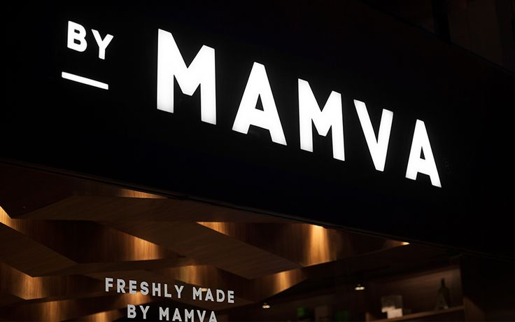 Brand identity and signage designed by Anagrama for health-food restaurant Mamva.