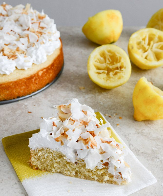 Easy Lemon Cake with Marshmallow Frosting + Toasted Coconut. #summer #cakes #dessert