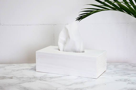 Wooden cover for a tissue box painted with quality white satin finish. Slightly sheer paint highlights the natural structure of pine wood and gives elegant, stylish look. Its minimalist, versatile design will complete various range of interior styles - from modern to rustic, which makes
