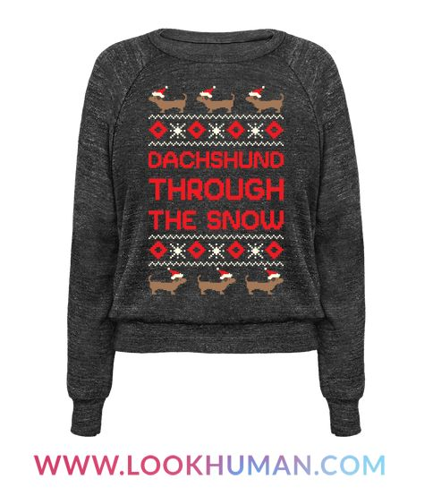 """Get a long little doggy this holiday season with this cute winner dog themed ugly Christmas Sweater. This design features illustrations of black and brown Dachshunds wearing Santa hats and the phrase """"Dachshund Through The Snow."""""""