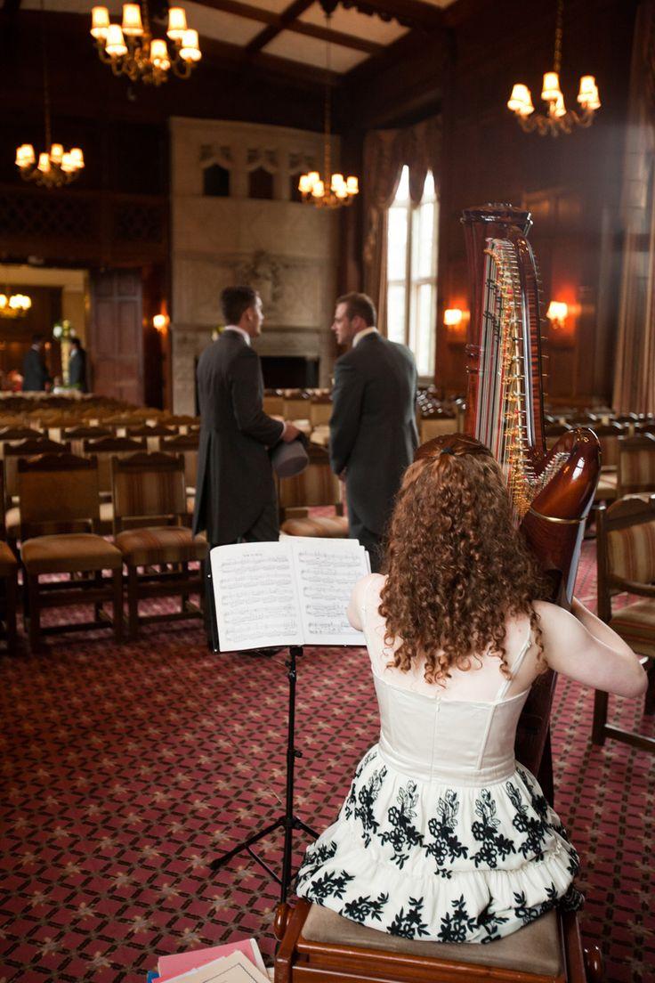 Harpist tuning up at Tylney Hall.