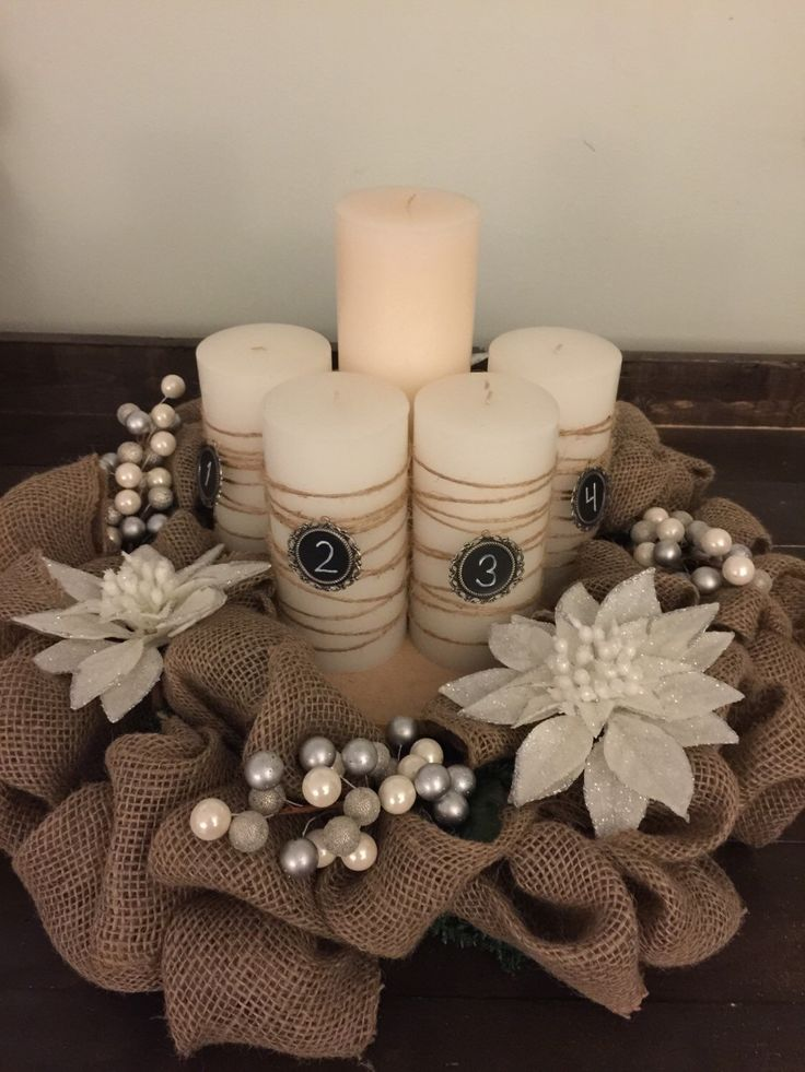 Advent Wreath with wrapped candles A personal favorite from my Etsy shop https://www.etsy.com/listing/248954136/burlap-white-poinsetta-advent-wreath