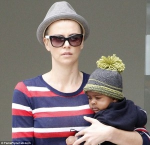 What is Charlize Theron doing shaving her head bald?!
