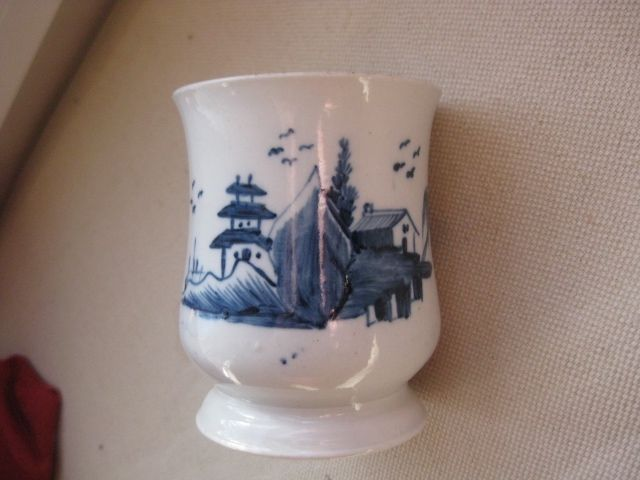 "A very rare Worcester  baluster shaped mug painted with an unrecorded pattern of a pagoda,trees and a house.With a grooved handle. Circa  1754   height   3 3/4"" Unmarked  Scratch cross period"