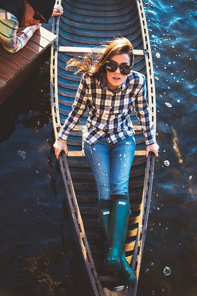 Flannel shirt, speckled distressed denim, hunter green Hunter boots, gray knee high socks.