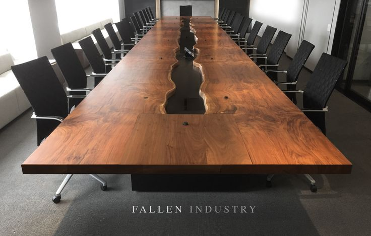 Live edge conference table / boardroom table with blackened steel channel down the center. Made from a fallen walnut tree.