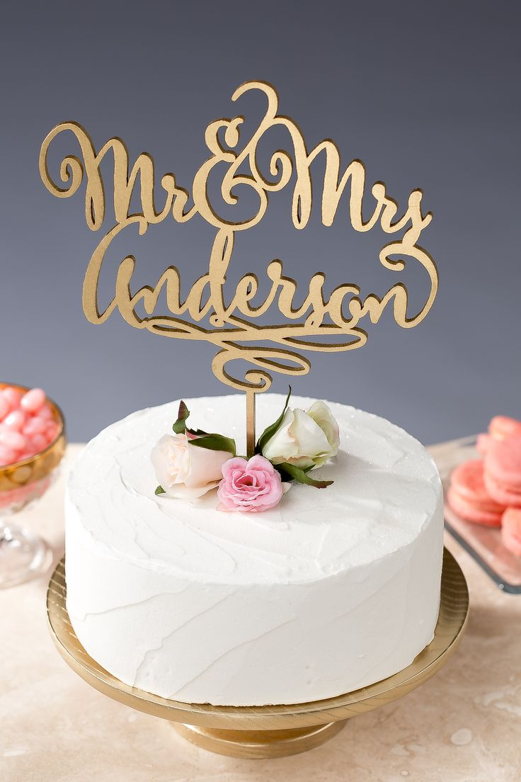 You're about to have a new last name! Sweeten up your wedding cake with this custom, handmade cake topper. Get the look at www.betteroffwed.etsy.com