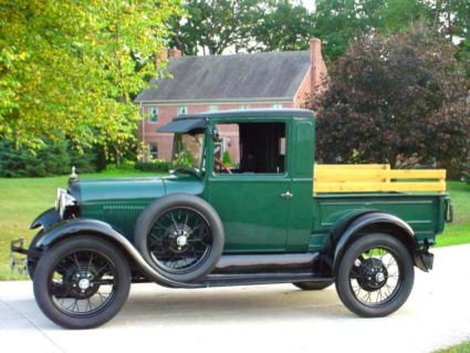 1928 Ford Model A pickup....I learned to drive on one just like this (different shade of green)...wish i still had it!
