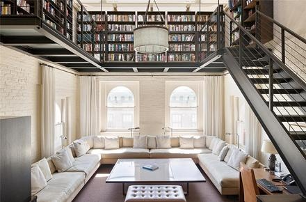 This would be my husband fanasty home... huge library. I must say... very cool. Not so much seating... but the idea of the upper library space is awesome!
