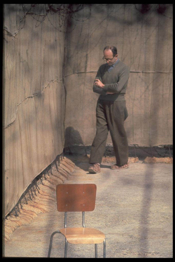 Adolf Eichmann walks around the yard of his cell, Israel, April 1961.  Eichman was a German Nazi SS-Obersturmbannführer (lieutenant colonel) and one of the major organisers of the Holocaust. Eichmann was charged with facilitating and managing the logistics of mass deportation of Jews to ghettos and extermination camps in German-occupied Eastern Europe during World War II. Following a widely publicized trial in Israel, he was found guilty of war crimes and hanged in 1962.