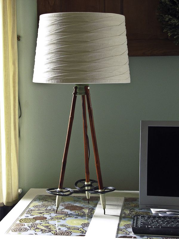 How clever! Using ski poles to craft an inexpensive tripod lamp.