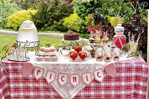 red gingham picnic party celebrates spring perfect for baby shower or birthday party dessert table with banner and wicker picnic basket