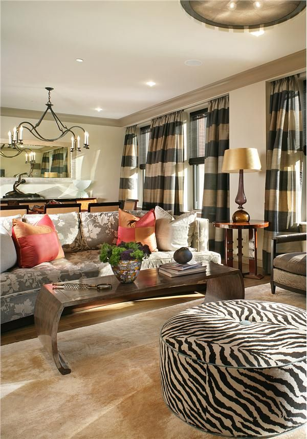 Not exactly my idea but I love the coral pillows w/the zebra ottoman & striped curtains