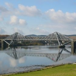 Connel Bridge is a cantilever bridge that spans Loch Etive at Connel in Scotland. The bridge takes the A828 road across the narrowest part of the loch, at the Falls of Lora.Completed on 9 May 1903, the bridge was built by Arrol's Bridge and Roof Company.