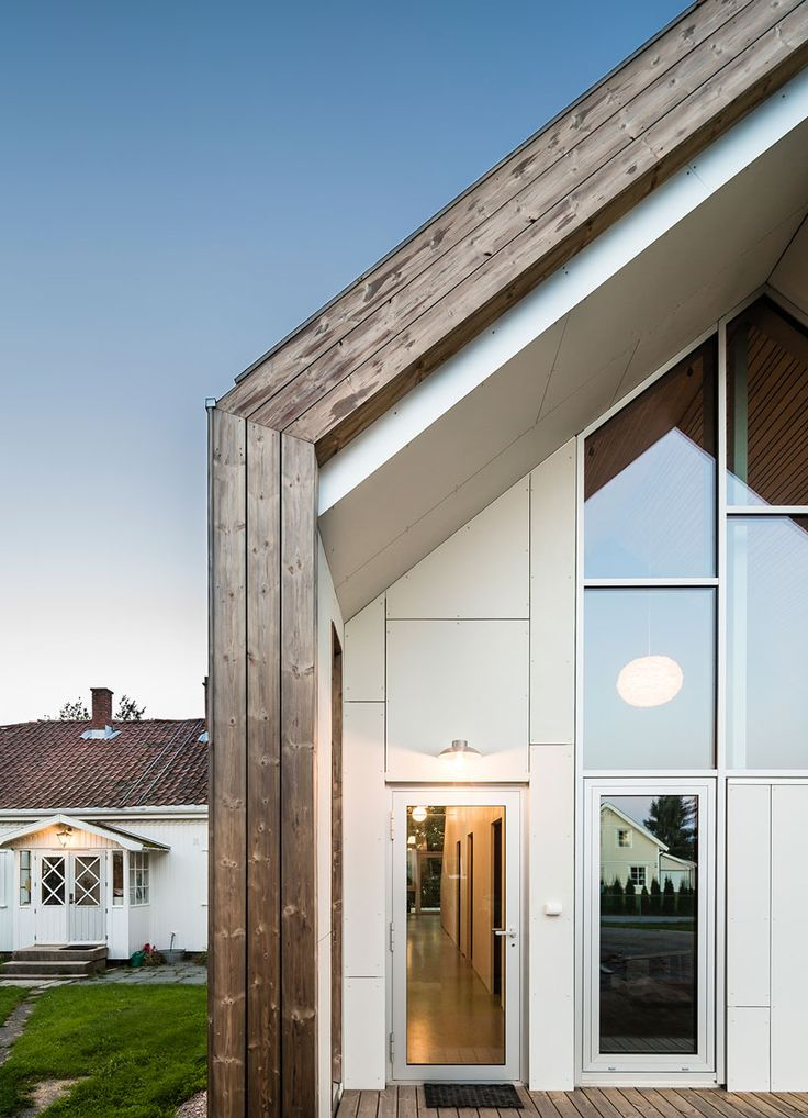 LINK arkitektur wraps contemporary gabled extension with kebony wood in norway