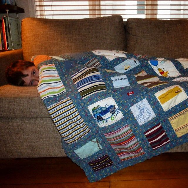 The t-shirt quilt by Nadine Flagel made a few years ago out of my son's stained or wornout shirts and pants.