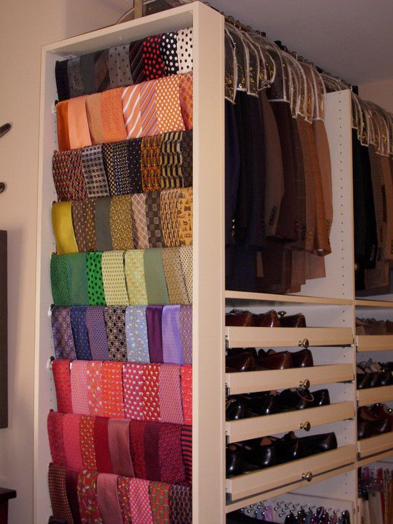 Tie Organizer, we created one of these systems that pulled out of the wall, we were able to store hundreds of ties for our client. The dowels were covered with ultrasuede to help keep the ties from slipping.