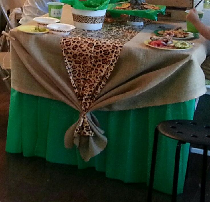 Lion King themed birthday party. Decor ideas. Burlap tablecloth. Cheetah print plastic table runner. Green plastic tablecover. Natural twine