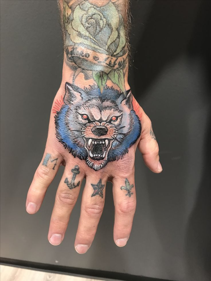 25 best ideas about wolf hand tattoo on pinterest l wen for Wolf tattoo traditional