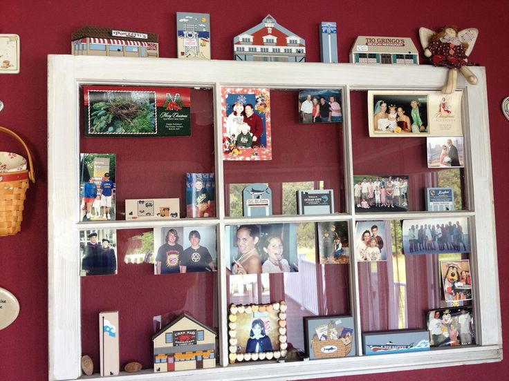 Pamela uses an old window to display photos and her favorite Cat's Meows from places she has traveled.