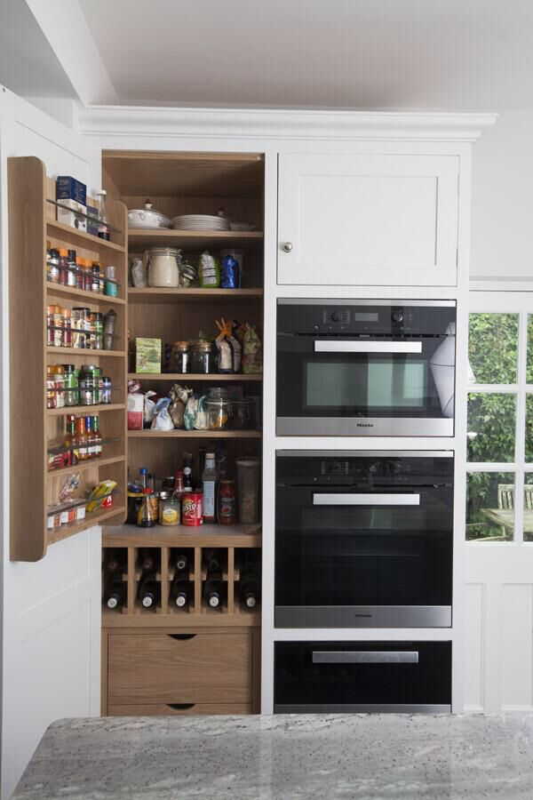 Oak interior, solid oak spice racks with polished aluminium rails, solid oak wine rack and pan drawers alongside a full stack of high quality Miele ovens and warming drawer