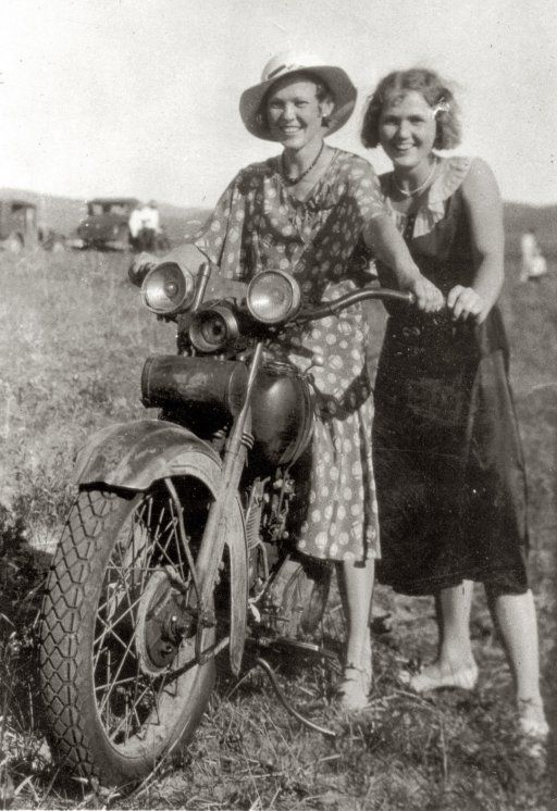 Two women riding a motorcycle in rural Nebraska, 1935. (I wish I had the dress on the right!)
