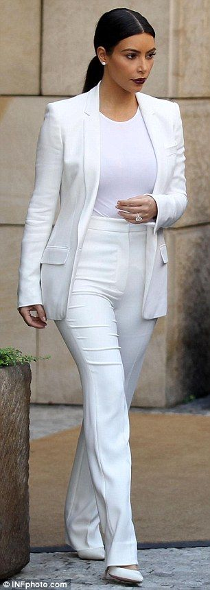 The couple Kim Kardashian West  Kanye West that dresses together, stays together! On Saturday, the pair opted for matching all-white outfits as they headed to Ploskovice Castle to celebrate Kanye's West stylist Renelou Padora's wedding