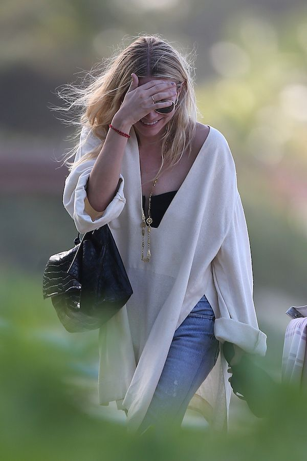 Olsens Anonymous Blog Ashley Olsen Twins Style St Barths Beachy Chic Wavy Hair Neutral Tunic Caftan Strapless Top The Row Croc Bag Distressed Ripped Jeans Sandals