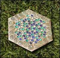 Crafty Chic: stepping stone with premade stepping stone  What You'll need:  • step stone (found at a home improvement store)  • grout. (It's easier to used premixed) • craft marbles, with the backs painted with acrylic paint in coordinating colors  • putty knife or strong, plastic knife