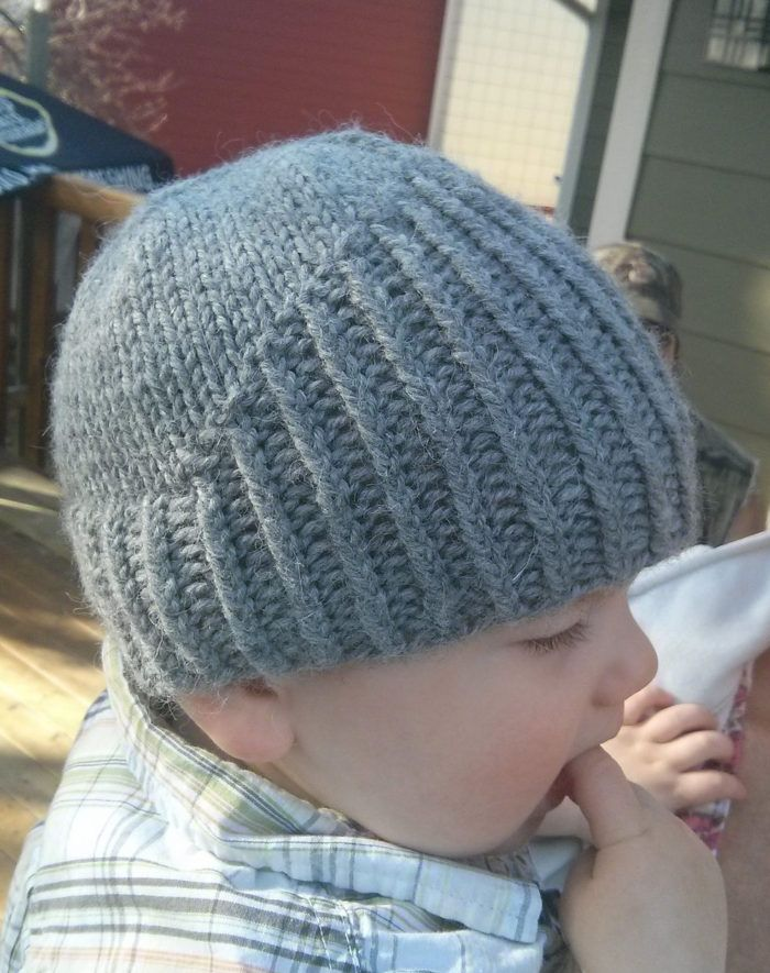 Free Knitting Pattern for Little Knight Baby Hat - Baby beanie inspired by knight helmets with the visor up. Designed by Olha. Pictured projectby naviverse who adapted it for a larger size.
