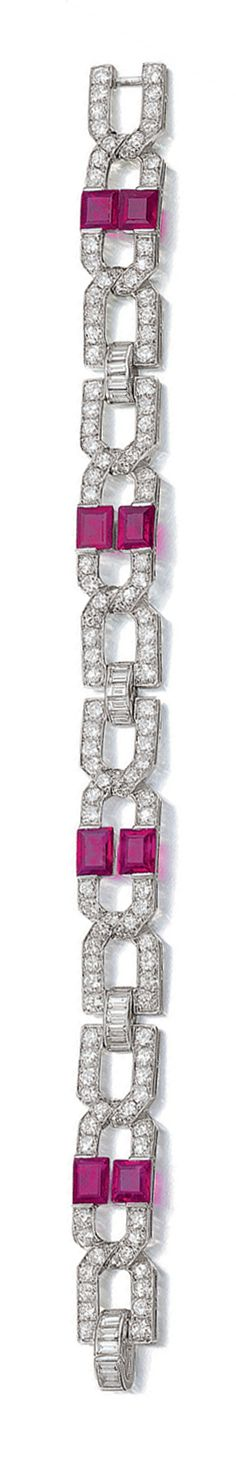 RUBY AND DIAMOND BRACELET, BULGARI, CIRCA 1925.  Designed as a series of geometric links set with baguette and circular-cut diamonds, highlighted with pairs of step-cut rubies, mounted in platinum,  signed Bulgari, French assay marks,