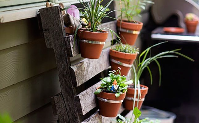 You only need a few materials to make this vertical planter.