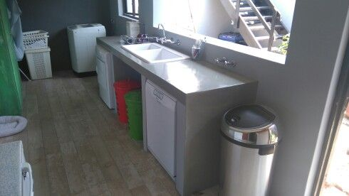 A small area in a double garage converted into new laundry and skullery area.concrete tops,new sink and tiled floors